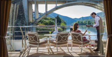 Passenger sitting on forward deck on Uniworld river cruise