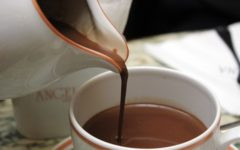 Hot chocolate being poured into white cup