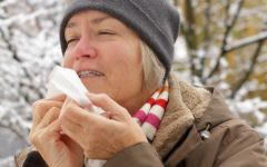woman with dry lips and tissue in winter