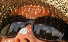 Woman in a straw hat and sunglasses